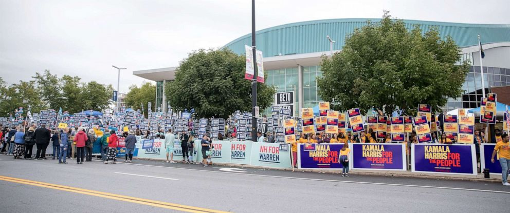 PHOTO: Supporters of various democratic presidential candidates hold signs outside of the New Hampshire Democratic Party Convention at the SNHU Arena, Sept. 7, 2019, in Manchester, New Hampshire.