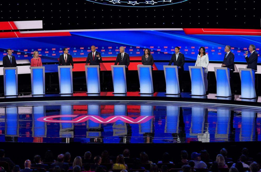 PHOTO: Democratic presidential candidate listen during Democratic Presidential Debate at the Fox Theatre July 31, 2019 in Detroit, Michigan.