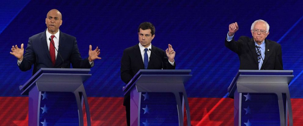 PHOTO: Democratic presidential hopefuls Cory Booker, Pete Buttigieg and Sen. Bernie Sanders gesture during the third Democratic primary debate of the 2020 presidential campaign season in Houston, Sept. 12, 2019.