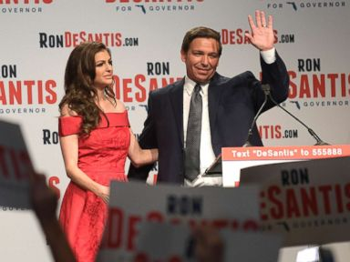 PHOTO: Florida Republican gubernatorial candidate Ron DeSantis, right, waves to supporters with his wife, Casey, at an election party after winning the Republican primary, Aug. 28, 2018, in Orlando, Fla.