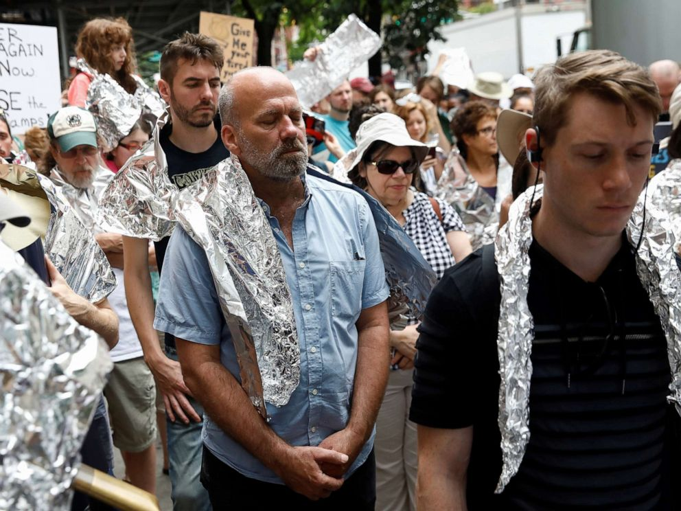 PHOTO: Demonstrators take a moment of silence in a Close the Camps rally to demand the closure of inhumane immigrant detention centers outside the Middle Collegiate Church in New York, July 2, 2019.