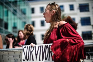 PHOTO: Meghan Downey of Chatham, N.J., protests as Education Secretary Betsy DeVos announces changes in federal policy on rules for investigating sexual assault reports on college campuses in Arlington, Va., Sept. 7, 2017.