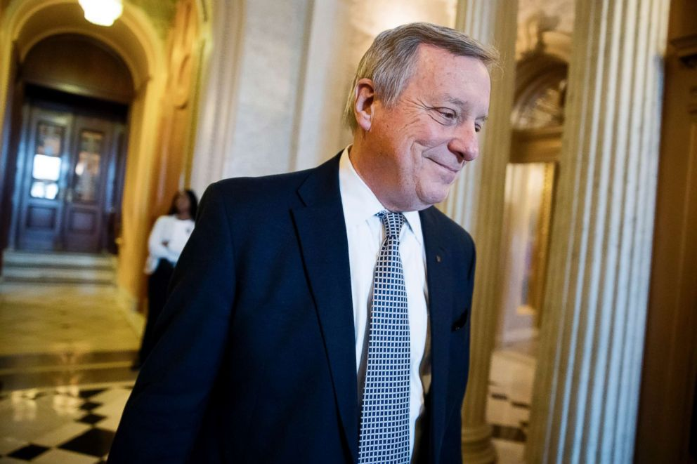 PHOTO: Sen. Dick Durbin (D-Ill), the Senate Democratic whip, smiles as he heads for a weekly policy luncheon on Capitol Hill, Dec. 12, 2017.