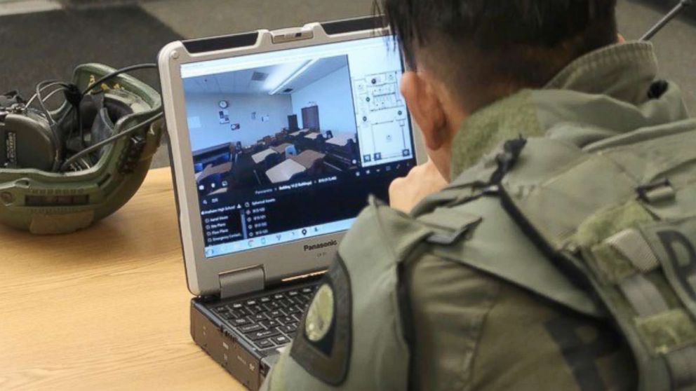 A tactical officer studies a digital-map of Anaheim High School on July 19, 2018, during a training exercise.