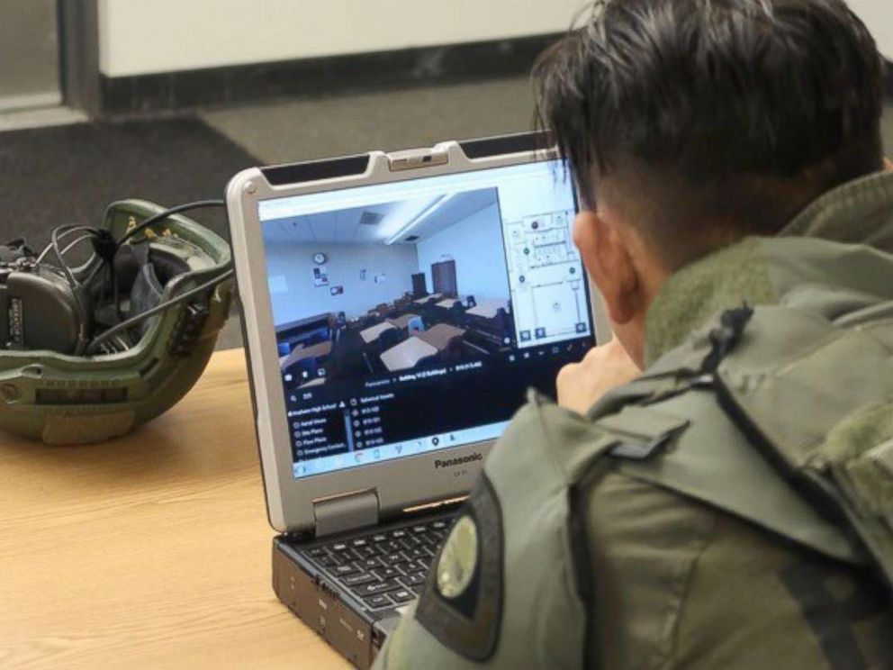PHOTO: A tactical officer studies a digital-map of Anaheim High School on July 19, 2018, during a training exercise.