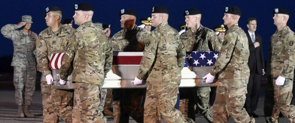 PHOTO: An Army carry team moves a transfer case containing the remains of Sgt. Dillon C. Baldridge at Dover Air Force Base, Del., June 12, 2017.