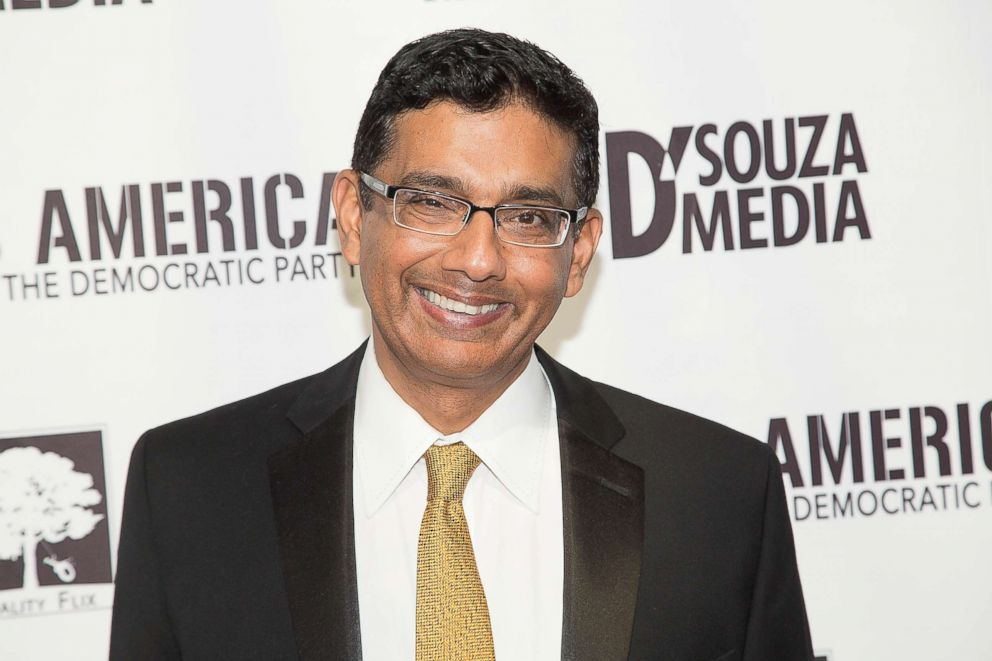 PHOTO: Dinesh DSouza arrives for the Los Angeles Premiere of, Hillarys America, July 11, 2016 in Hollywood, California.