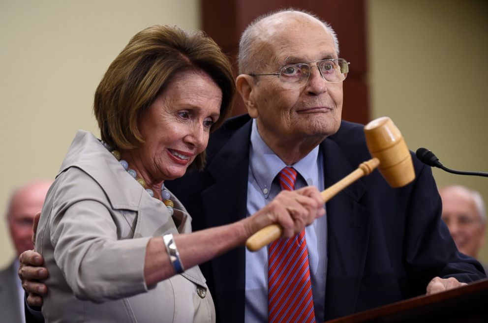 PHOTO: In this July 29, 2015 file photo, House Minority Leader Nancy Pelosi of Calif., standing with former Rep. John Dingell, D-Mich., holds up the gavel Dingell used 50 years ago when Medicare legislation was passed.