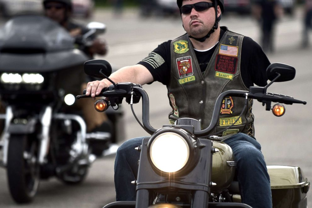 A disabled veteran arrives as thousands of bikers and military veterans gather at the Pentagon parking area ahead of the 31st annual Rolling Thunder Ride for Freedom motorcycle parade in Arlington, May 27, 2018.