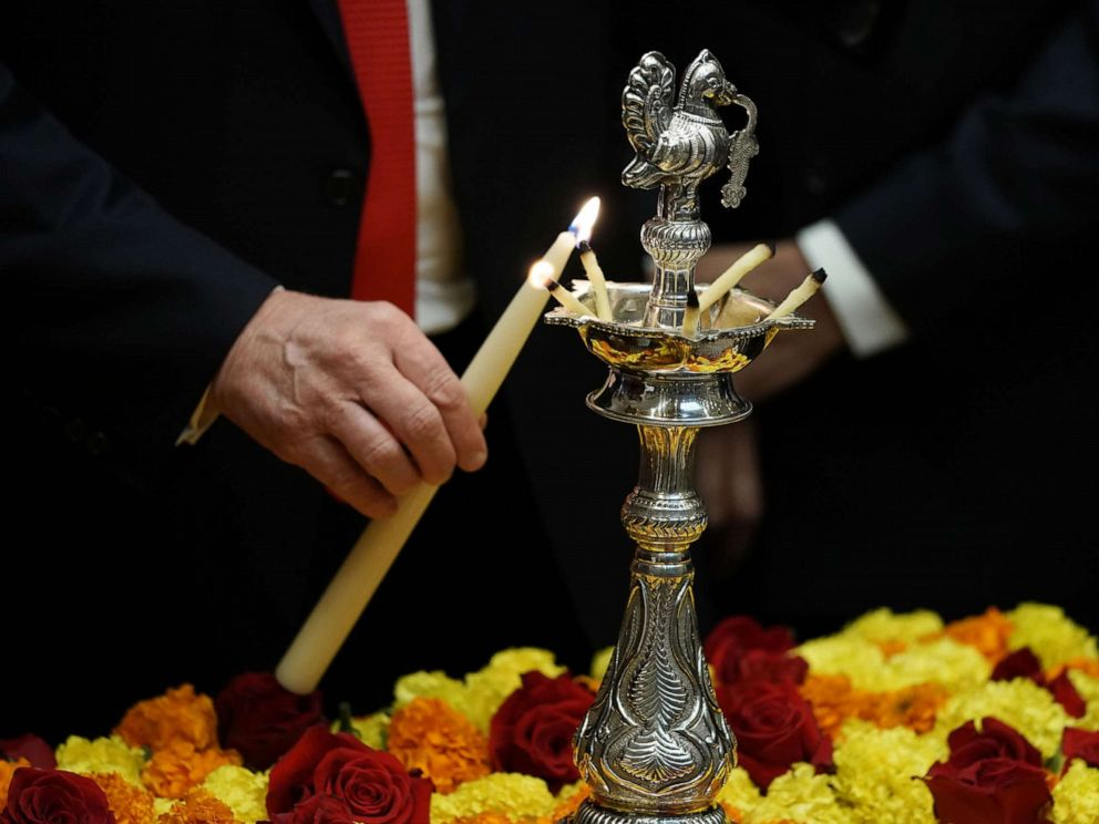 PHOTO: President Donald Trump lights a diya as during a Diwali ceremony in the Roosevelt Room of the White House, Nov. 13, 2018.