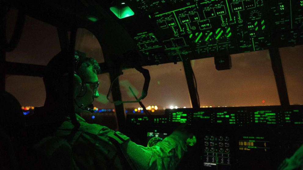 A U.S. Air Force pilot assigned to the 75th Expeditionary Airlift Squadron, 449th Air Expeditionary Group conducts post-flight procedures on board a C-130J Super Hercules at Camp Lemonnier, Djibouti, April 5, 2016.