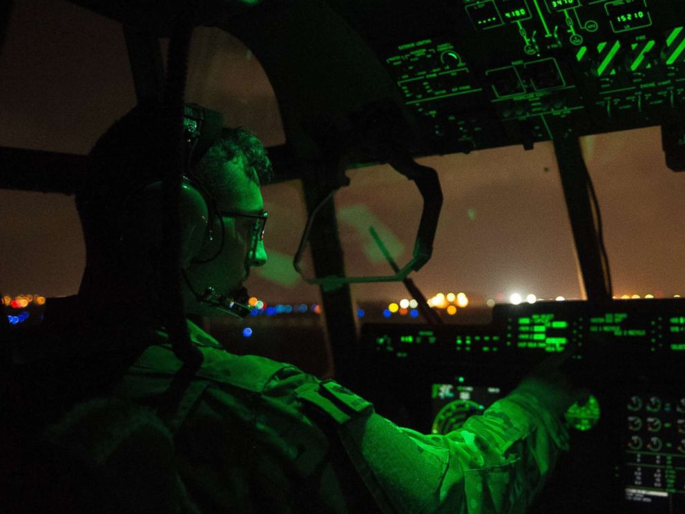PHOTO: A U.S. Air Force pilot assigned to the 75th Expeditionary Airlift Squadron, 449th Air Expeditionary Group conducts post-flight procedures on board a C-130J Super Hercules at Camp Lemonnier, Djibouti, April 5, 2016.
