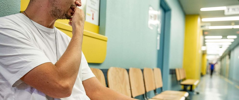 PHOTO: A young man waits in a hospital corridor in this undated stock photo.