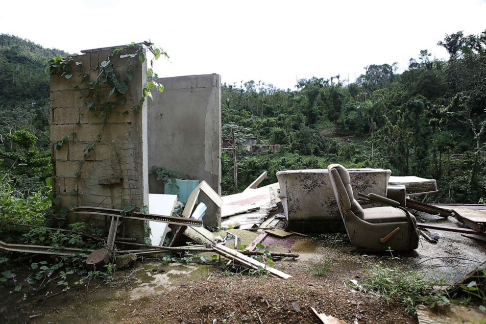 PHOTO: The remains of a destroyed home stand, Dec. 19, 2017, in Utuado, Puerto Rico. Barely three months after Hurricane Maria made landfall, approximately one-third of the devastated island is still without electricity and 14 percent lack running water.
