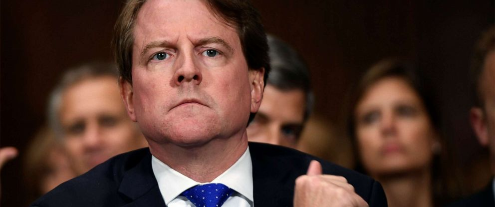 PHOTO: White House counsel Don McGahn listens as Supreme court nominee Brett Kavanaugh testifies before the Senate Judiciary Committee on Capitol Hill in Washington, Sept. 27, 2018.