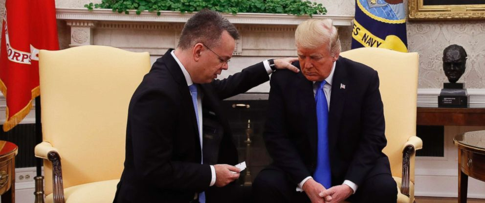 PHOTO: President Donald Trump prays with American pastor Andrew Brunson in the Oval Office of the White House, Oct. 13, 2018, in Washington.