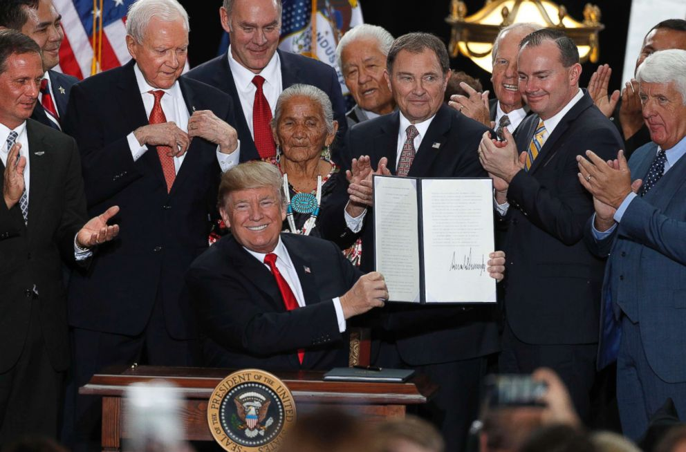 PHOTO: With Utah officials surrounding him, President Donald Trump shows an executive order he signed reducing the Grand Staircase-Escalante National Monument at the Rotunda of the Utah State Capitol, Dec. 4, 2017 in Salt Lake City, Utah.