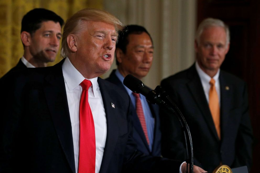 President Donald Trump (2nd L), flanked by House Speaker Paul Ryan (L), Foxconn Chairman Terry Gou (C) and Senator Ron Johnson (R), delivers remarks at a White House event in Washington, D.C., July 26, 2017.