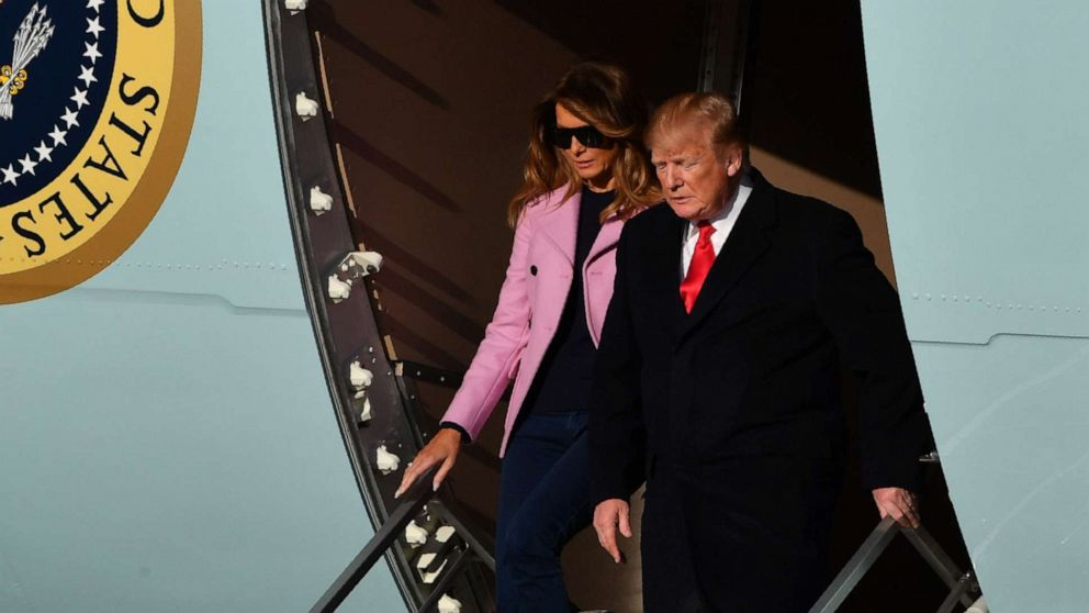 President Donald Trump and first lady Melania Trump step off Air Force One upon arrival at Andrews Air Force Base in Maryland.