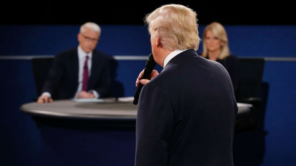 Moderators Anderson Cooper and Martha Raddatz listen as Republican presidential nominee Donald Trump speaks during the second debate at Washington University in St. Louis, Missouri on Oct. 9, 2016.
