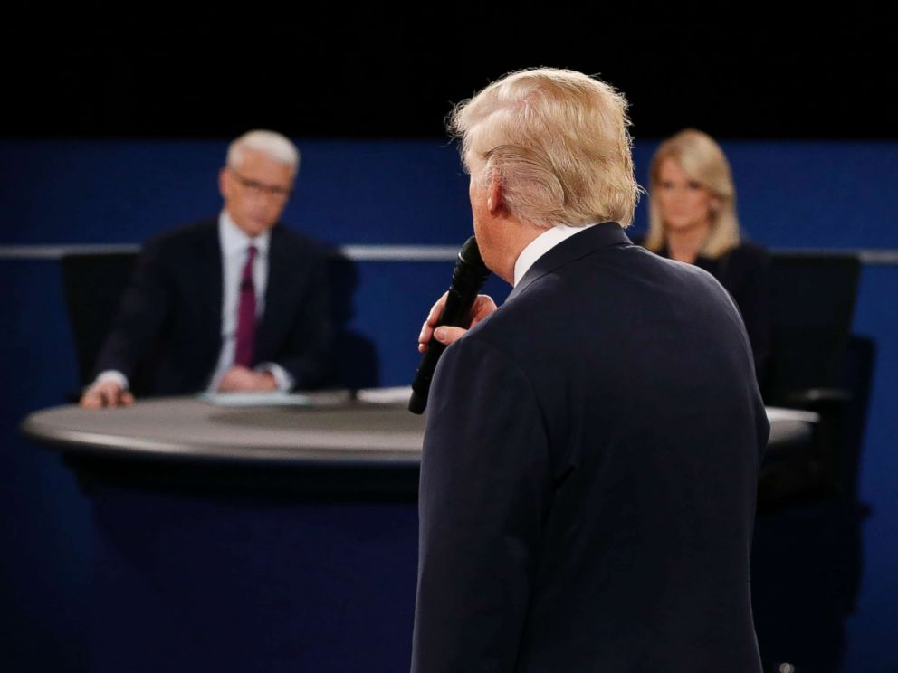PHOTO: Moderators Anderson Cooper and Martha Raddatz listen as Republican presidential nominee Donald Trump speaks during the second debate at Washington University in St. Louis, Missouri on Oct. 9, 2016.
