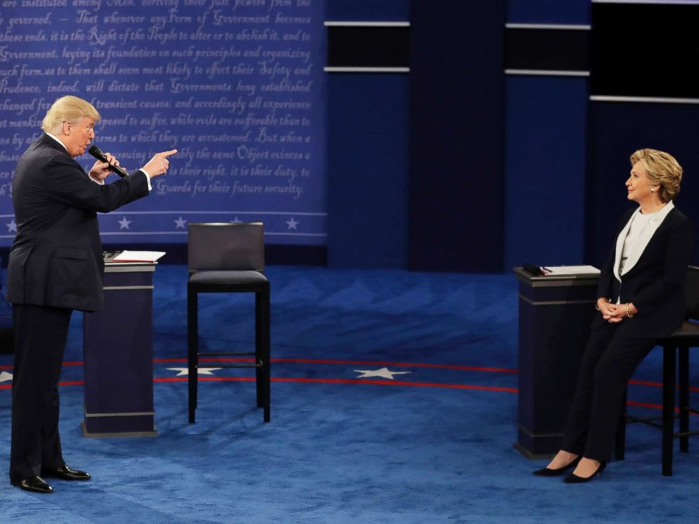PHOTO: Republican presidential nominee Donald Trump speaks to Democratic presidential nominee Hillary Clinton during the second presidential debate in St. Louis, Oct. 9, 2016.