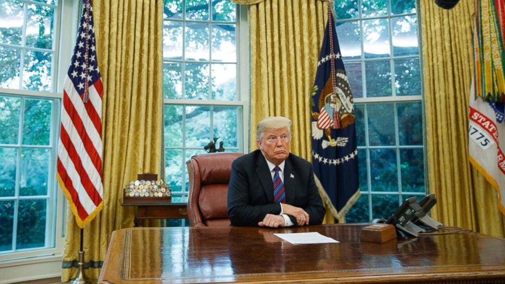 President Donald Trump listens during a phone call with Mexican President Enrique Pena Nieto about a trade agreement between the US and Mexico, in the Oval Office of the White House, Aug. 27, 2018.