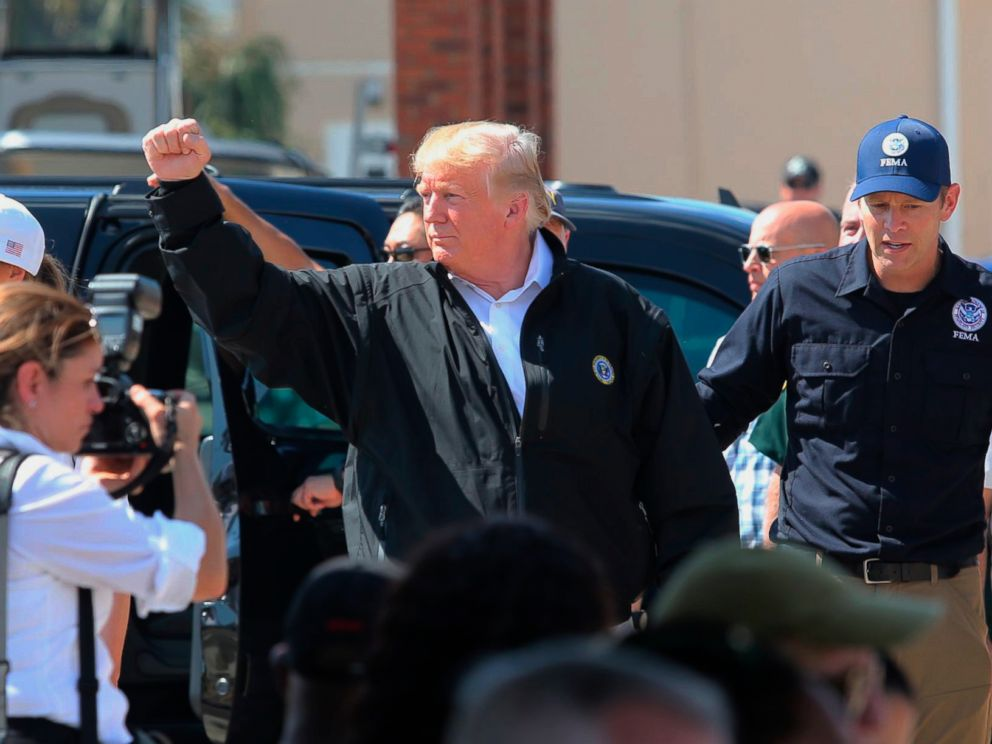 PHOTO: President Donald Trump raises his fist to chants of USA during a visit Monday, Oct. 15, 2018, to Lynn Haven, Fla., to see storm damage and recovery efforts following Hurricane Michael.