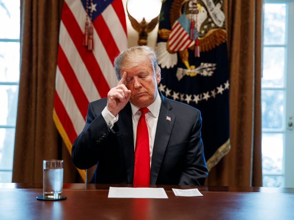 PHOTO: President Donald Trump looks at his notes before speaking during an event on human trafficking in the Cabinet Room of the White House, Friday, Feb. 1, 2019, in Washington.