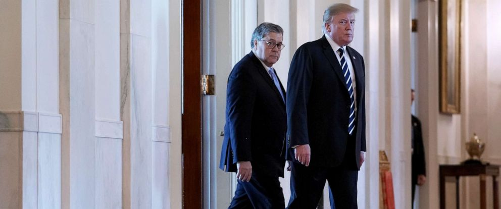 PHOTO: President Donald Trump and U.S. Attorney General William Barr arrive together for an event in the East Room of the White House, May 22, 2019, in Washington.