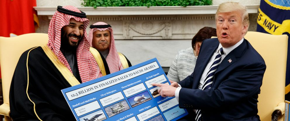 PHOTO: President Donald Trump shows a chart highlighting arms sales to Saudi Arabia during a meeting with Saudi Crown Prince Mohammed bin Salman in the Oval Office of the White House in Washington on March 20, 2018.