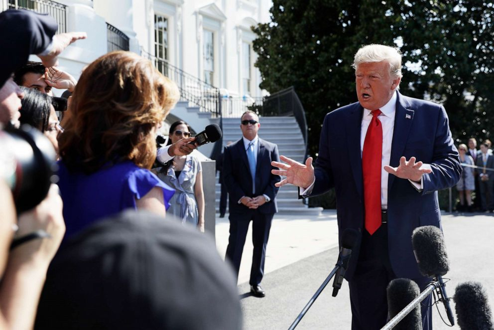 PHOTO: President Donald Trump talks to reporters on the South Lawn of the White House, Friday, Aug. 9, 2019, in Washington.
