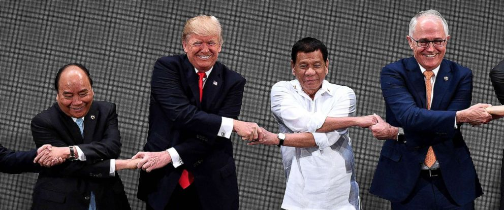 PHOTO: Vietnams Prime Minister Nguyen Xuan Phuc, President Donald Trump, Philippine President Rodrigo Duterte, Australia Prime Minister Malcolm Turnbull, link hands during the the 31st ASEAN Summit in Manila Philippines, Nov. 13, 2017.