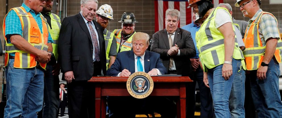 PHOTO: President Donald Trump signss an executive order on energy and infrastructure during a campaign event at the International Union of Operating Engineers International Training and Education Center in Crosby, Texas, April 10, 2019.