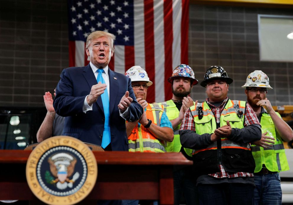 PHOTO: President Donald Trump is applauded during a campaign event at the International Union of Operating Engineers International Training and Education Center in Crosby, Texas, April 10, 2019.