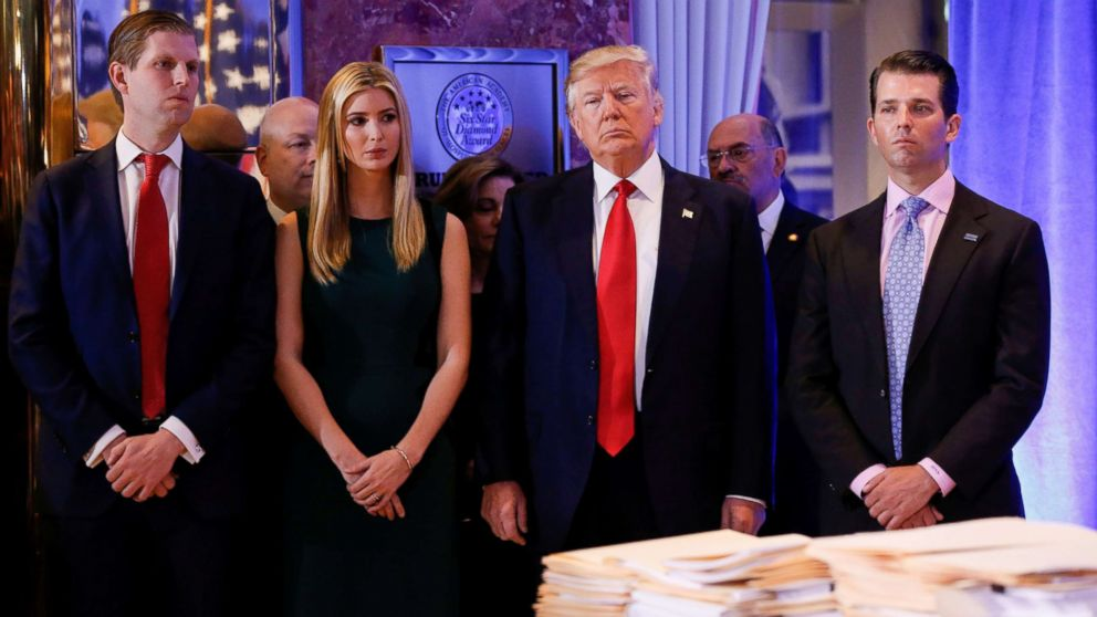 President-elect Donald Trump stands surrounded by his son Eric Trump, daughter Ivanka and son Donald Trump Jr., ahead of a press conference in Trump Tower in New York in this Jan. 11, 2017 file photo.