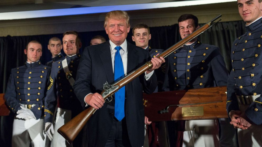 Reality TV host and New York real estate mogul Donald Trump holds up a replica flintlock rifle awarded him by cadets during the Republican Society Patriot Dinner at the Citadel Military College, Feb. 22, 2015 in Charleston, S.C.