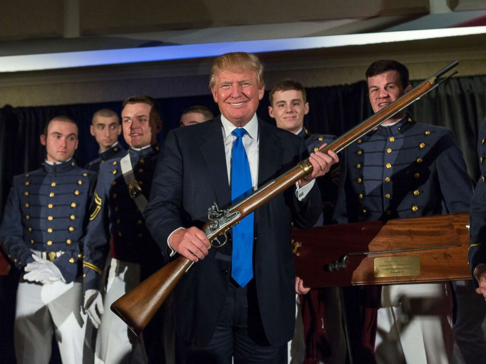 PHOTO: Reality TV host and New York real estate mogul Donald Trump holds up a replica flintlock rifle awarded him by cadets during the Republican Society Patriot Dinner at the Citadel Military College, Feb. 22, 2015 in Charleston, S.C.