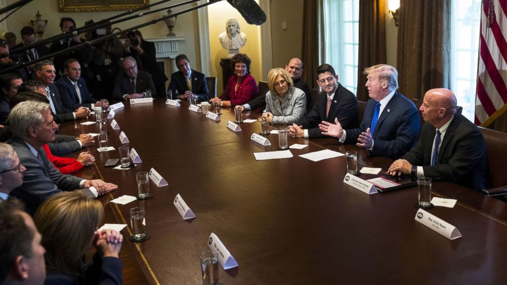 President Donald Trump speaks about tax reform legislation, flanked by Speaker of the House Paul Ryan and House Ways and Means Committee chairman Rep. Kevin Brady, during a meeting with members of the House Ways and Means Committee in the Cabinet Room at the White House, Nov. 2, 2017.
