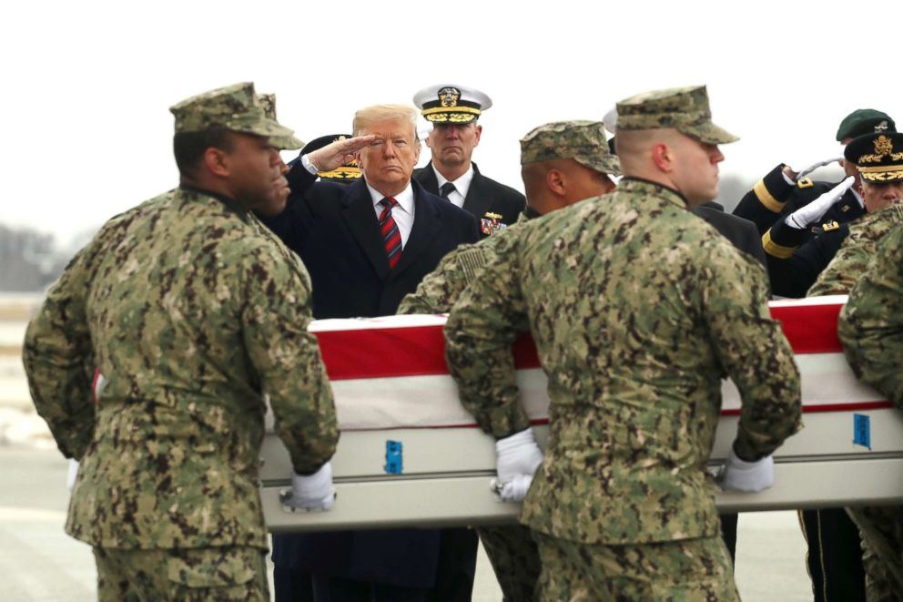 PHOTO: President Donald Trump salutes as a military carry team moves the transfer case containing the remains of Scott A. Wirtz during a dignified transfer at Dover Air Force Base in Dover, Del., Jan 19, 2019.