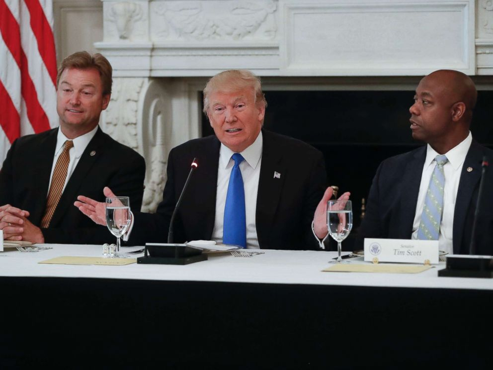 PHOTO: President Donald Trump, flanked by Sen. Dean Heller, R-Nev., left, and Sen. Tim Scott, R-S.C.,speaks at a luncheon with GOP leadership, July 19, 2017, in the State Dining Room of the White House in Washington.