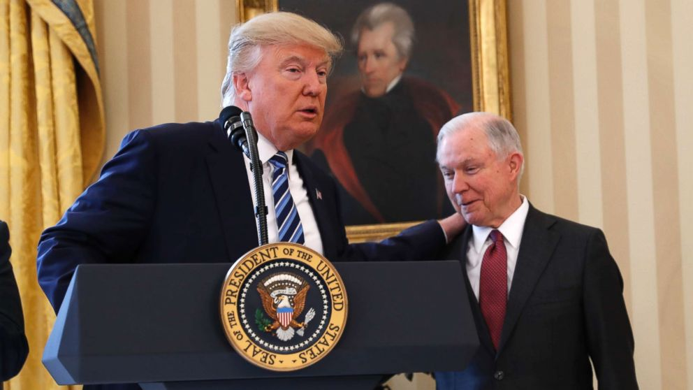 President Donald Trump talks to Attorney General Jeff Sessions in the Oval Office of the White House, Feb. 9, 2017, before Vice President Mike Pence administered the oath of office Sessions.