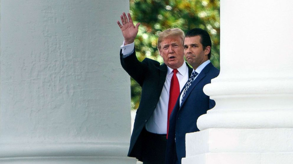 President Donald Trump (L) and his son Donald Trump, Jr., walk to a motorcade from the North Portico of the White House on July 5, 2018 in Washington, D.C.