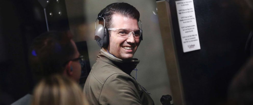 PHOTO: Donald Trump Jr., center, reacts after firing an AR-15 rifle inside a gun range during a campaign event at CrossRoads Shooting Sports in Johnston, Iowa, Jan. 30, 2016.