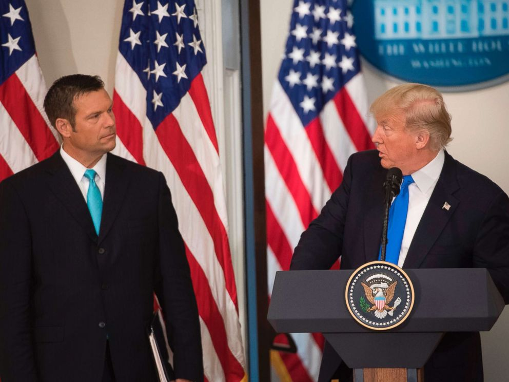 PHOTO: President Donald Trump speaks alongside Kansas Secretary of State Kris Kobach (L) during the first meeting of the Presidential Advisory Commission on Election Integrity in the Eisenhower Executive Office Building in Washington, D.C., July 19, 2017.