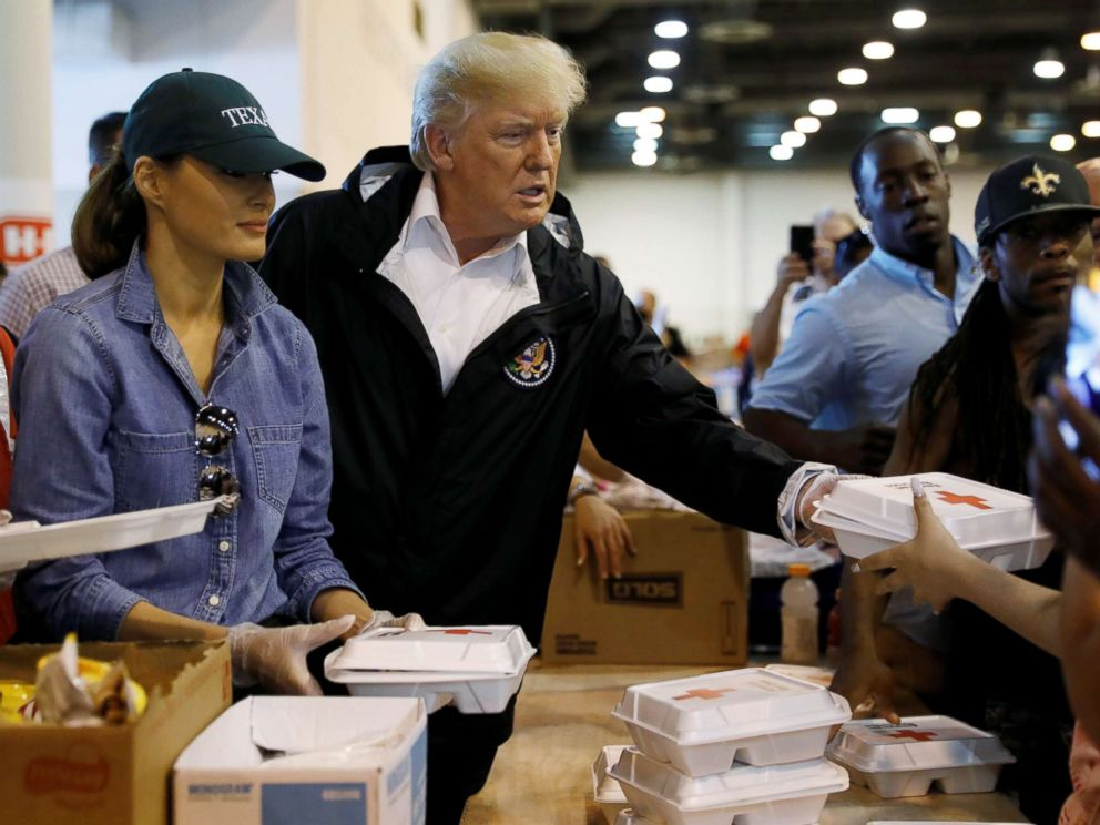 PHOTO: President Donald Trump and first lady Melania Trump help volunteers hand out meals during a visit with flood survivors of Hurricane Harvey at a relief center in Houston, Sept. 2, 2017.