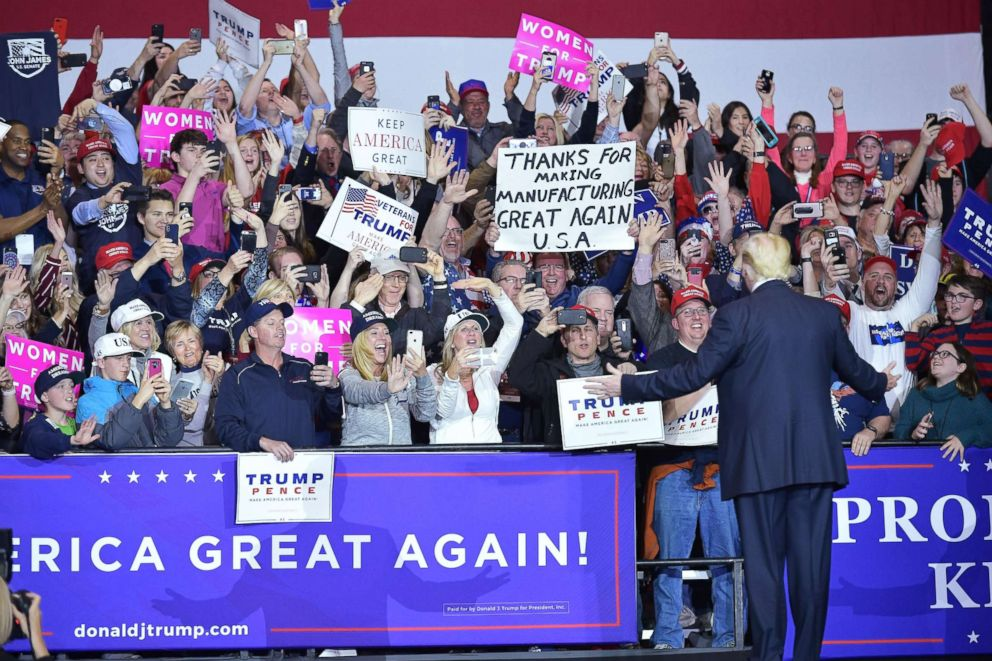 President Donald Trump walks on stage at a rally at Total Sports Park in Washington, Michigan, April 28, 2018.