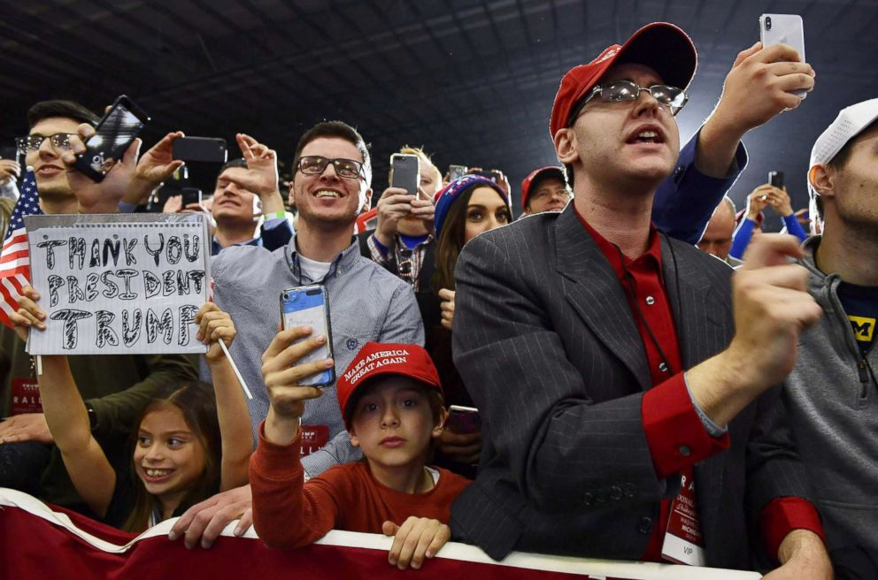 PHOTO: Supporters of President Donald Trump look on as he speaks during a rally at Total Sports Park in Washington, Michigan, April 28, 2018.