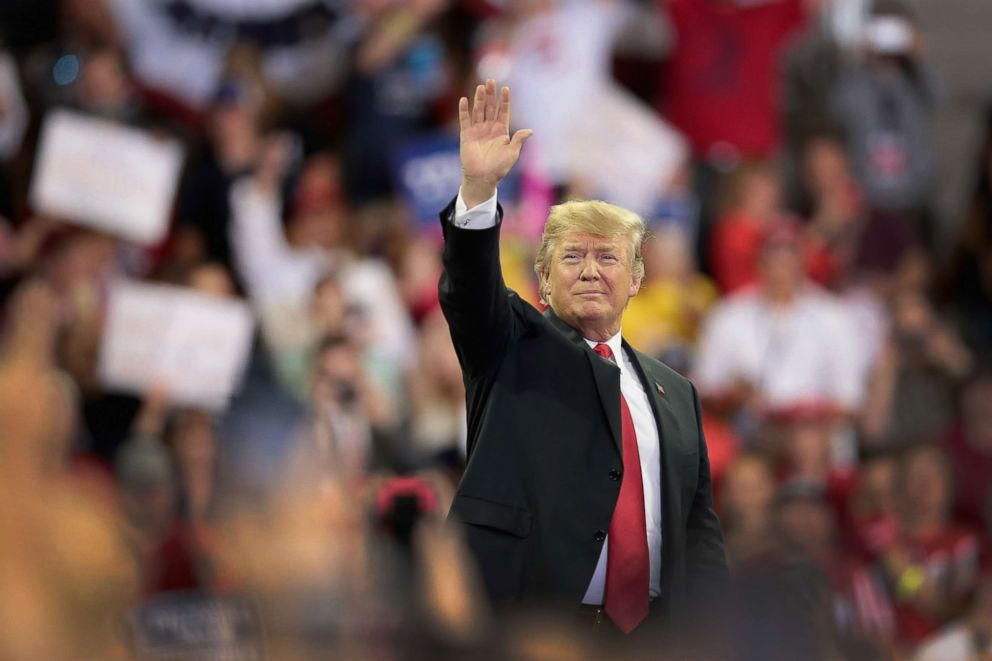 President Donald Trump greets supporters as he arrives for a campaign rally at the Amsoil Arena, June 20, 2018, in Duluth, Minnesota.