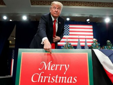 PHOTO: President Donald Trump points to a Merry Christmas placard on the stage as he arrives to deliver remarks on tax reform in St. Louis, Mo., Nov. 29, 2017.
